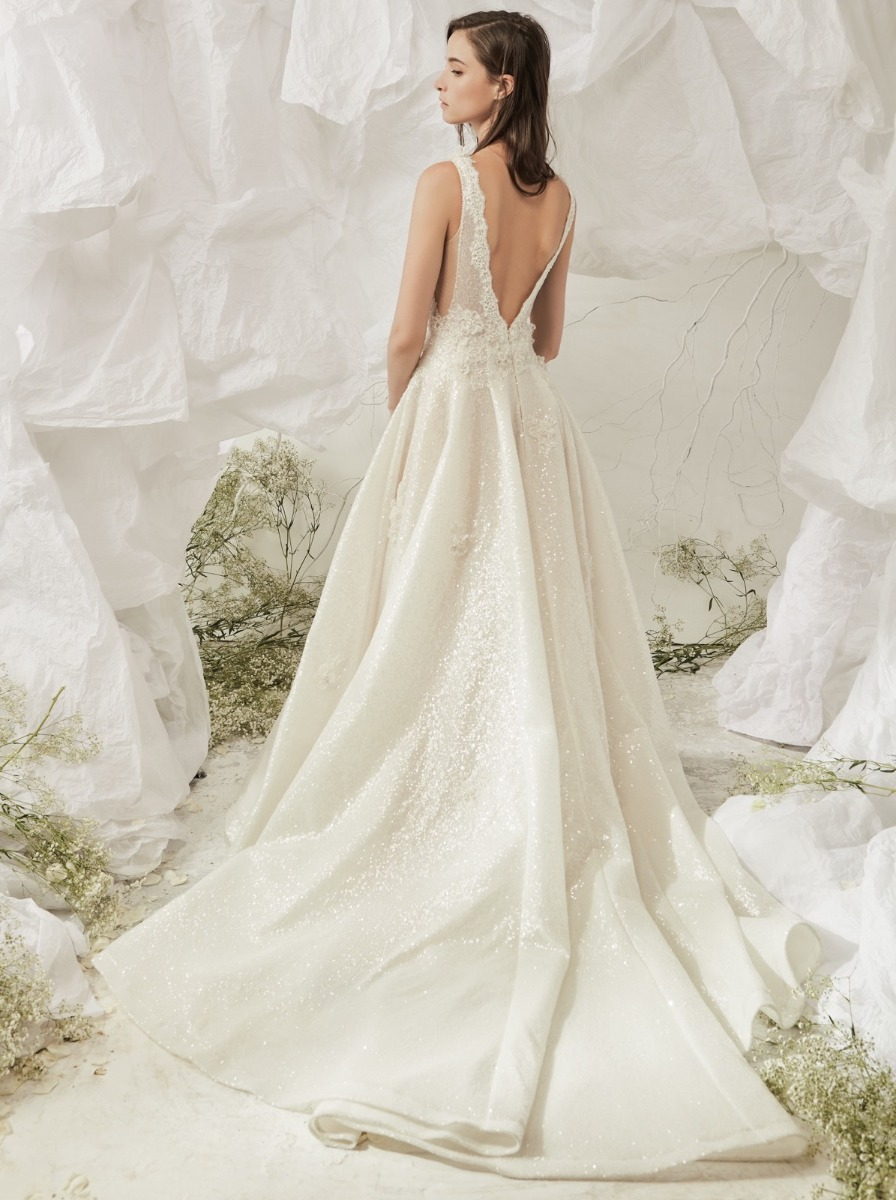 Plunging V-back with beaded lace trim and long train.
