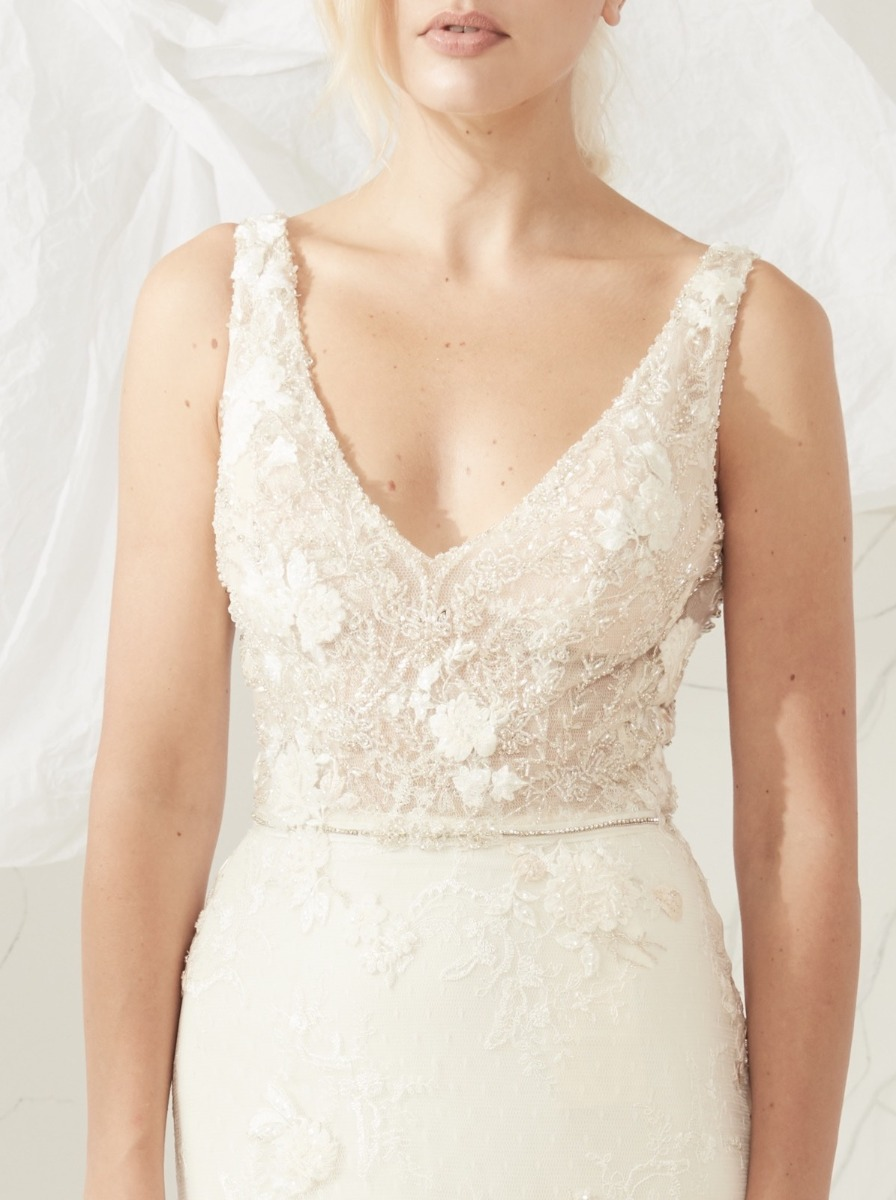 Mermaid wedding dress with glistening embroidery on the bodice and beaded French flowers detailing along the skirt.