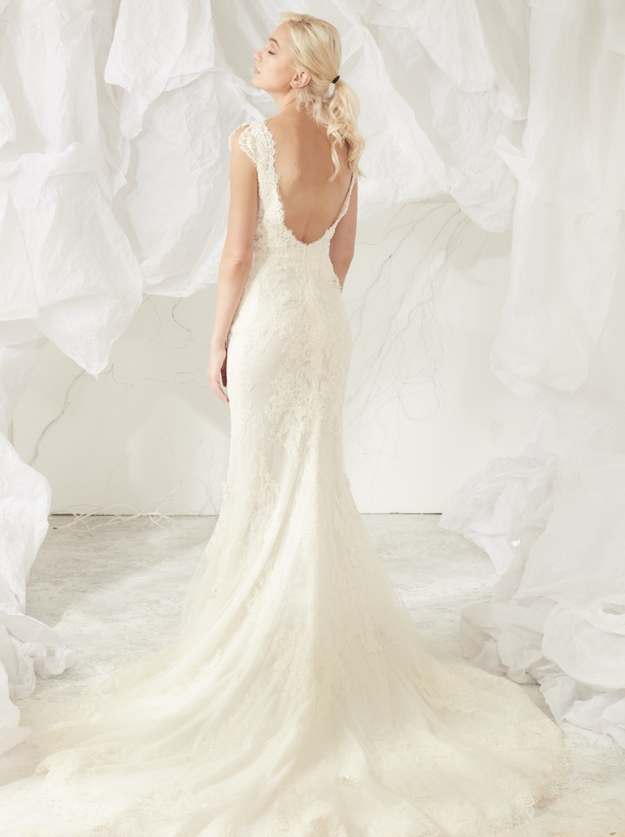 Wide open back with lace trim and cap sleeves.