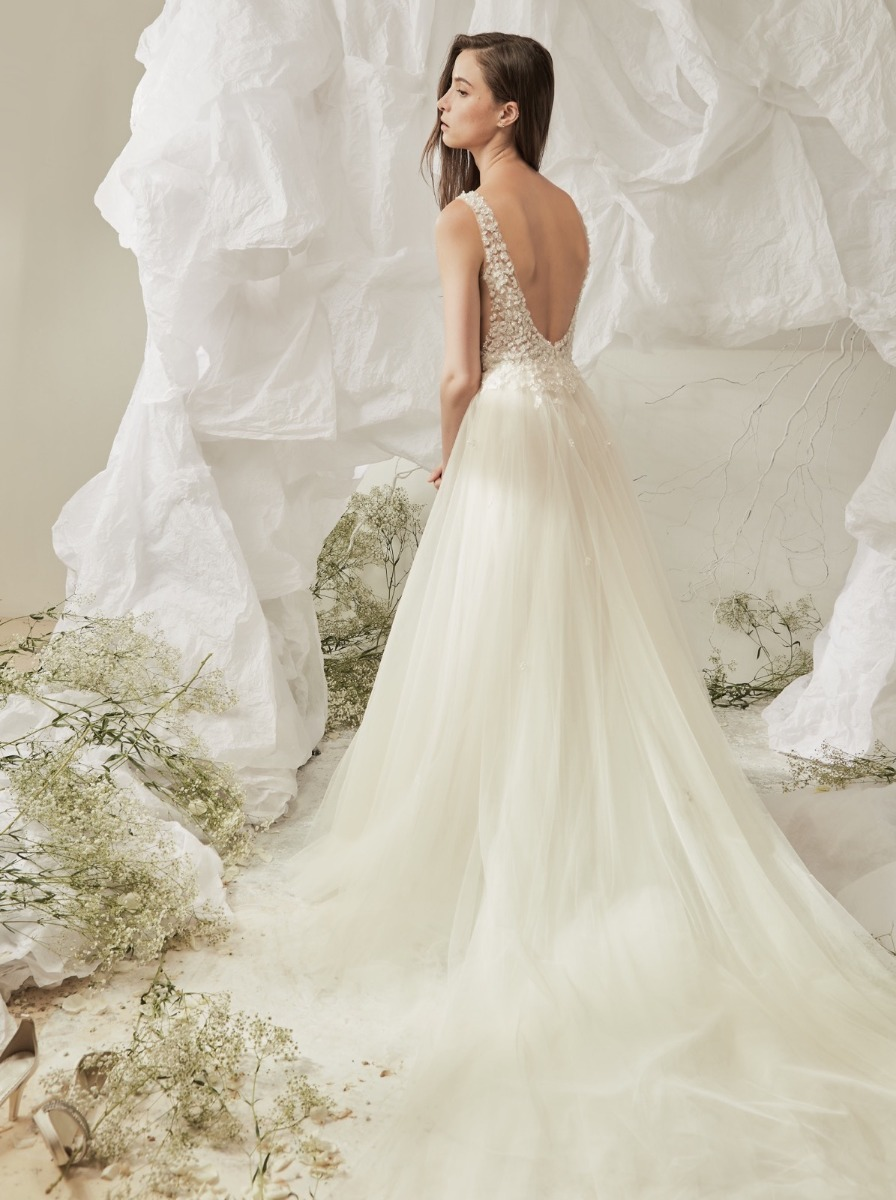 Open back with sequined motifs over illusion straps with long train.