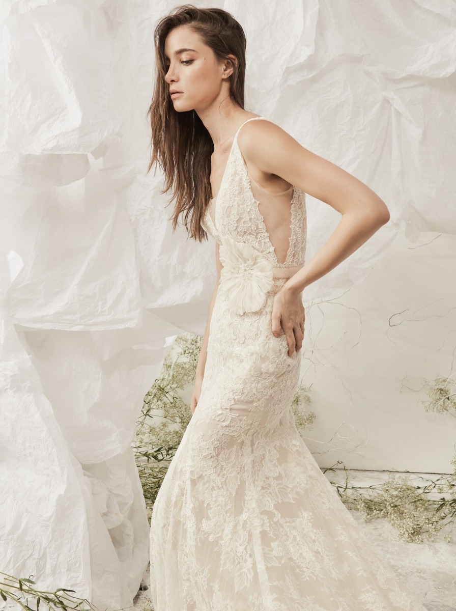 Mermaid wedding dress in lace with graphic beaded silk flowers at the side of the waist.