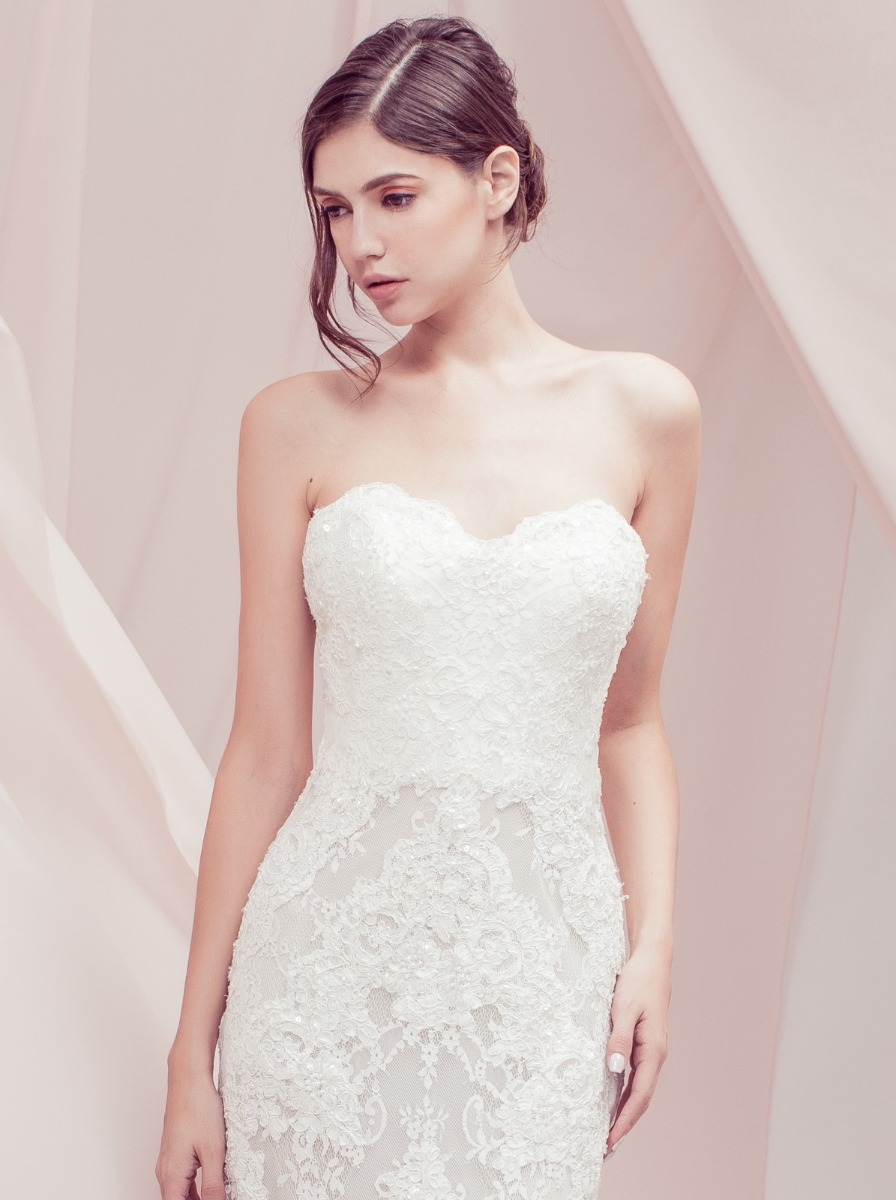 Classic mermaid wedding dress in lace with shimmering beaded appliques on the bodice and skirt.