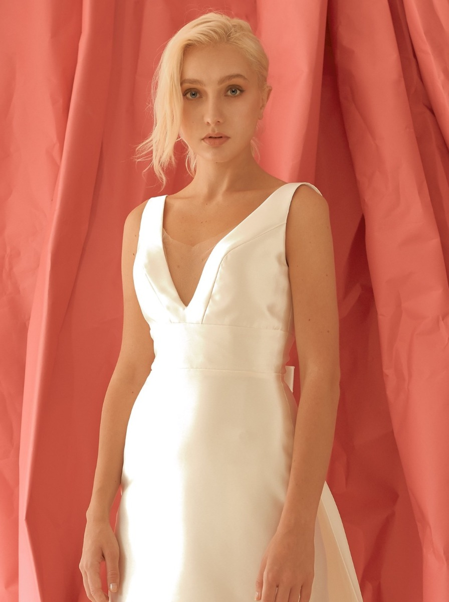 Column wedding dress in Mikado with a fitted, V-neckline bodice.