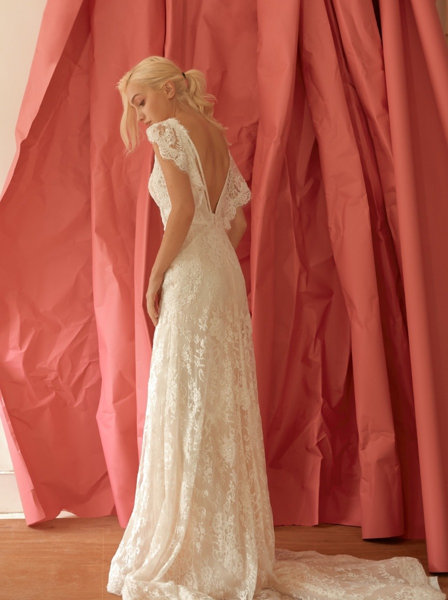 Plunging V-back with cascades of small lace ruffles.